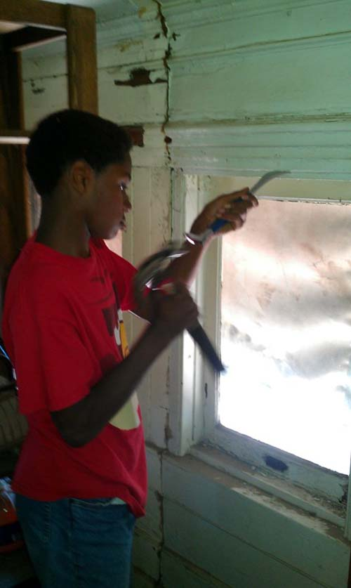 Jelani working on the window frames